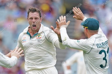 James Pattinson (L) of Australia celebrates dismissing BJ Watling of New Zealand on day three of the Boxing Day Test match between Australia and New Zealand at the Melbourne Cricket Ground (MCG) in Melbourne, Australia, 28 December 2019.