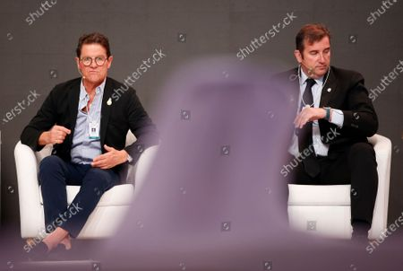 Stock Photo of Italian former soccer coach and player Fabio Capello (L) speaks during the first day of the Dubai International Sports Conference in Dubai, United Arab Emirates, 28 December 2019. This year is the 14th Dubai International Sports Conference.