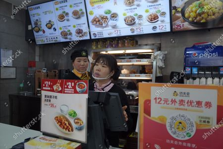 Stock Image of Waitresses work in a Real KungFu fast food restaurant in Beijing, China, 28 December 2019. A company run by Shannon Lee, the daughter of KungFu icon Bruce Lee, has filed a lawsuit seeking over 210 million yuan (about 26.8 million euro) in compensation against a popular Chinese fast food chain over its alleged use of her father's image in its logo without permission, media reported.