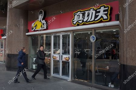 Stock Picture of Customers enter a Real KungFu fast food restaurant in Beijing, China, 28 December 2019. A company run by Shannon Lee, the daughter of KungFu icon Bruce Lee, has filed a lawsuit seeking over 210 million yuan (about 26.8 million euro) in compensation against a popular Chinese fast food chain over its alleged use of her father's image in its logo without permission, media reported.