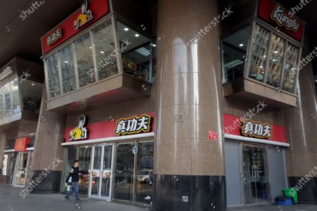 Customers enter in a Real KungFu fast food restaurant in Beijing, China, 28 December 2019. A company run by Shannon Lee, the daughter of KungFu icon Bruce Lee, has filed a lawsuit seeking over 210 million yuan (about 26.8 million euro) in compensation against a popular Chinese fast food chain over its alleged use of her father's image in its logo without permission, media reported.