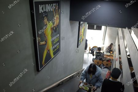 Stock Photo of People have lunch in a Real KungFu fast food restaurant in Beijing, China, 28 December 2019. A company run by Shannon Lee, the daughter of KungFu icon Bruce Lee, has filed a lawsuit seeking over 210 million yuan (about 26.8 million euro) in compensation against a popular Chinese fast food chain over its alleged use of her father's image in its logo without permission, media reported.