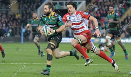 Northampton's Northampton's Cobus Reinach (Man of the match) receives a pass from Tom Collins and charges in for a try in the second half.Gloucester's Franco Mostert (chasing)