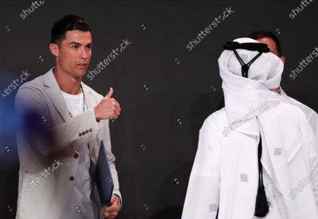 HH Sheikh Mansour bin Mohammed bin Rashid Al Maktoum(R), President of the Dubai International Marine Club attends with Cristiano Ronaldo (L), Portuguese international Cristiano Ronaldo of Juventus Turin during the 14th edition of Dubai International Sports Conference in Dubai, United Arab Emirates, 28 December 2019. The conference was launched in 2006 to bring football stakeholders together.