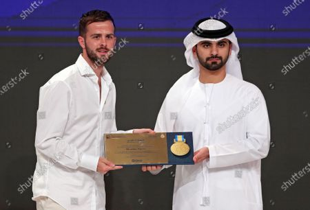 Bosnian international Miralem Pjanic (L) of Juventus receives a Honor Certificate of Appreciation from Sheikh Mansour bin Mohammed bin Rashid Al Maktoum (L), President of the Dubai International Marine Club, during the 14th edition of Dubai International Sports Conference in Dubai, United Arab Emirates, 28 December 2019. The conference was launched in 2006 to bring football stakeholders together.