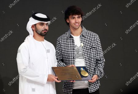 Portuguese international Joao Felix (R) of Atletico Madrid receives a Honor Certificate of Appreciation from Sheikh Mansour bin Mohammed bin Rashid Al Maktoum (L), President of the Dubai International Marine Club, during the 14th edition of Dubai International Sports Conference in Dubai, United Arab Emirates, 28 December 2019. The conference was launched in 2006 to bring football stakeholders together.
