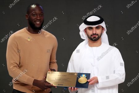 Belgium international Romelu Lukaku (L) of Inter Milan receives a Honor Certificate of Appreciation from Sheikh Mansour bin Mohammed bin Rashid Al Maktoum (R), President of the Dubai International Marine Club, during the 14th edition of Dubai International Sports Conference in Dubai, United Arab Emirates, 28 December 2019. The conference was launched in 2006 to bring football stakeholders together.