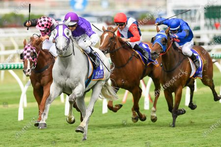 Jockey Brad Stewart rides The Candy Man to victory in race 4, the Magic Millions Shoot Out, during the Metro Races at Eagle Farm in Brisbane, Queensland, Australia, 28 December 2019.