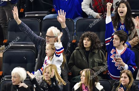 Stock Image of Tim Robbins, Marlowe Martino, Gratiela Brancusi and Miles Robbins attend Carolina Hurricanes vs New York Rangers game at Madison Square Garden