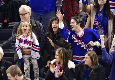 Stock Photo of Tim Robbins, Marlowe Martino, Gratiela Brancusi and Miles Robbins attend Carolina Hurricanes vs New York Rangers game at Madison Square Garden