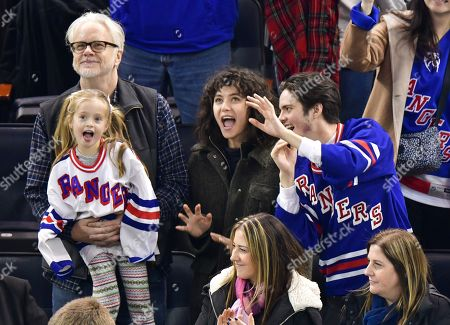 Tim Robbins, Marlowe Martino, Gratiela Brancusi and Miles Robbins attend Carolina Hurricanes vs New York Rangers game at Madison Square Garden
