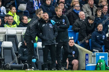 Adam Brett, Head of Medical Services for Brighton & Hove Albion FC talking with Billy Reid, Assistant Head Coach of Brighton & Hove Albion FC during the Premier League match between Brighton and Hove Albion and Bournemouth at the American Express Community Stadium, Brighton and Hove