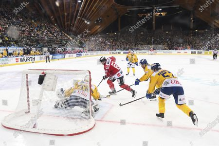 (L-R) Davos' Joren van Pottelberghe, versus Team Canada`s Nick Ross during the game between Team Canada and HC Davos, at the 93th Spengler Cup ice hockey tournament in Davos, Switzerland, 28 December 2019.