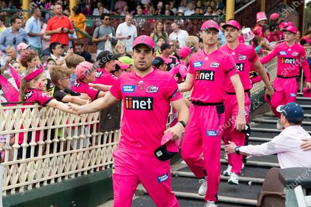 Sydney Sixers captain Moises Henriques leads his players onto the field