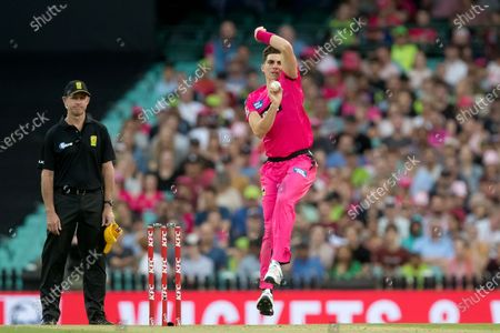Stock Image of Sydney Sixers player Sean Abbott bowls