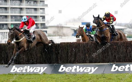 Defi Sacre and James Best win the Betway Handicap at Newbury from Vado Forte [right].