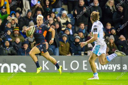 Stock Picture of Darcy Graham (#14) of Edinburgh Rugby runs past Ruaridh Jackson (#15) of Glasgow Warriors to score the final try during the 1872 Cup second leg Guinness Pro14 2019_20 match between Edinburgh Rugby and Glasgow Warriors at BT Murrayfield Stadium, Edinburgh