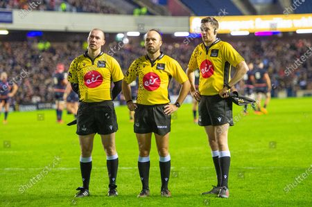 Stock Picture of Referee Mike Adamson (centre) and touch judges Keith Allen (left) and David Sutherland watch the television reply during the 1872 Cup second leg Guinness Pro14 2019_20 match between Edinburgh Rugby and Glasgow Warriors at BT Murrayfield Stadium, Edinburgh