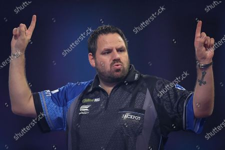 Adrian Lewis (England) reacts during his Fourth Round game against Dimitri Van den Bergh (Belgium) (not in picture) in the PDC William Hill World Darts Championship at Alexandra Palace, London