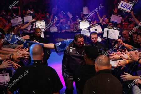 Adrian Lewis (England), walk-on, before his Fourth Round game against Dimitri Van den Bergh (Belgium) (not in picture) in the PDC William Hill World Darts Championship at Alexandra Palace, London