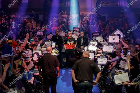 Dimitri Van den Bergh (Belgium), walk-on, before his Fourth Round game against Adrian Lewis (England) (not in picture) in the PDC William Hill World Darts Championship at Alexandra Palace, London