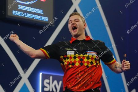 Dimitri Van den Bergh (Belgium) celebrates his Fourth Round win over Adrian Lewis (England) (not in picture) in the PDC William Hill World Darts Championship at Alexandra Palace, London