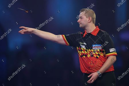 Dimitri Van den Bergh (Belgium) throwing during his Fourth Round game against Adrian Lewis (England) (not in picture) in the PDC William Hill World Darts Championship at Alexandra Palace, London