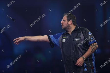 Adrian Lewis (England) throwing during his Fourth Round game against Dimitri Van den Bergh (Belgium) (not in picture) in the PDC William Hill World Darts Championship at Alexandra Palace, London