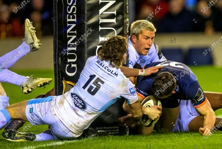 Stock Photo of Edinburgh vs Glasgow. Glasgow's Ruaridh Jackson stops Matt Scott of Edinburgh scoring at the base of the post