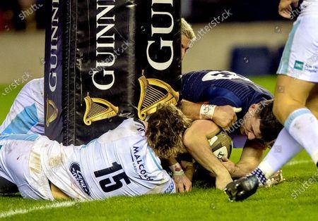 Edinburgh vs Glasgow. Glasgow's Ruaridh Jackson stops Matt Scott of Edinburgh scoring at the base of the post