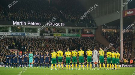 Stock Image of Tottenham Hotspur and Norwich City players stand for a minutes silence for the late Martin Peters