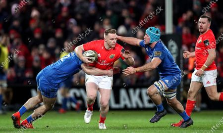 Munster vs Leinster. Munster's Rory Scannell tackled by Conor O'Brien and Will Connors of Leinster