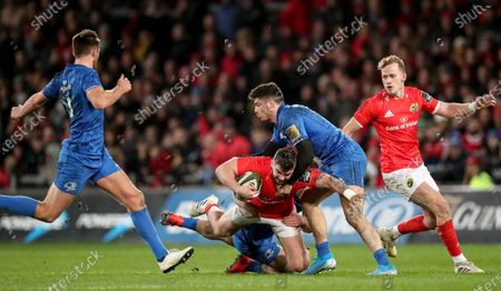 Munster vs Leinster. Munster's Rory Scannell tackled by Conor O'Brien and Jimmy O'Brien of Leinster