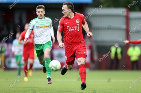 Stock Photo of Larne vs Cliftonville. Larne's Albert Watson in acton with Cliftonville's Ryan. Curran