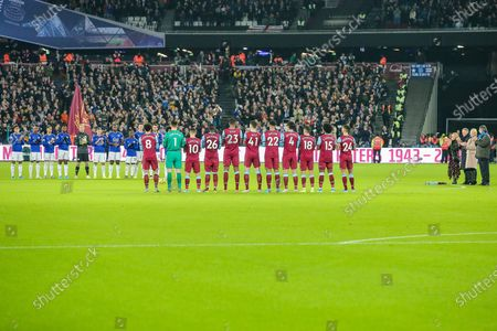 Players pay tribute to Hammers and England legend, Martin Peters who recently passed away by way of a minute's applause as his family look on during the Premier League match between West Ham United and Leicester City at the London Stadium, London