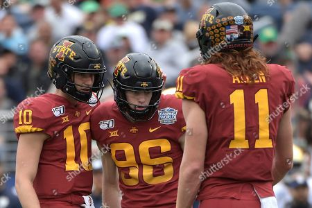 Stock Photo of Iowa State place kicker Connor Assalley (96) is congratulated by holder Blake Clark (10) and tight end Chase Allen (11) after making a field goal during the first half of the Camping World Bowl NCAA college football game against Notre Dame, in Orlando, Fla