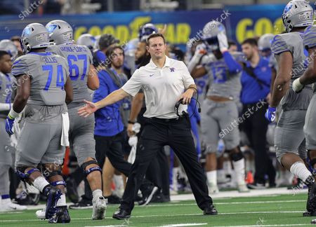 New Memphis head coach Ryan Silverfield greets his special teams players as they go to the sidelines during the Goodyear Cotton Bowl Classic football game between the Memphis Tigers and the Penn State Nittany Lions at AT&T Stadium in Arlington, TX