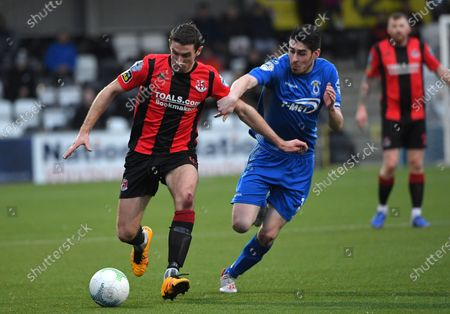 Crusaders vs Dungannon Swifts. Crusaders Gary Thompson in action with Dungannon's Kris Love