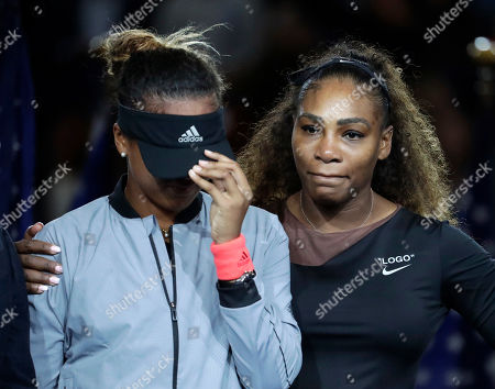 Shows Naomi Osaka, of Japan, being hugged by Serena Williams after Osaka defeated Williams in the women's final of the U.S. Open tennis tournament, in New York. Williams has been voted the AP Female Athlete of the Decade for 2010 to 2019. Williams won 12 of her professional-era record 23 Grand Slam singles titles over the past 10 years. No other woman won more than three in that span. She also tied a record for most consecutive weeks ranked No. 1 and collected a tour-leading 37 titles in all during the decade. Gymnast Simone Biles finished second in the vote by AP member sports editors and AP beat writers. Swimmer Katie Ledecky was third, followed by ski racers Lindsey Vonn and Mikaela Shiffrin