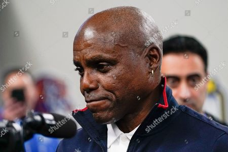 Olympic sprinter Carl Lewis is seen on the sidelines during the first half in the NCAA Cotton Bowl college football game between Penn State and Memphis, in Arlington, Texas