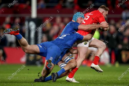 Munster vs Leinster. Munster's Rory Scannell is tackled by Conor O'Brien and Will Connors of Leinster