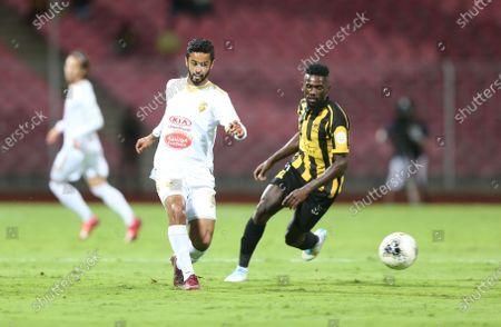 AL-Ittihad's Abdulaziz Al Bishi (R) in action against Fateh's Mohammed Al Saeed (L) during the Saudi Professional League soccer match between AL-Ittihad and Fateh at King Abdullah Sport City Stadium, Jeddah, Saudi Arabia, 28 December 2019.