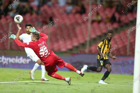 AL-Ittihad's Abdulaziz Al Bishi (R) in action against Fateh's Maxim Koval (L) during the Saudi Professional League soccer match between AL-Ittihad and Fateh at King Abdullah Sport City Stadium, Jeddah, Saudi Arabia, 28 December 2019.