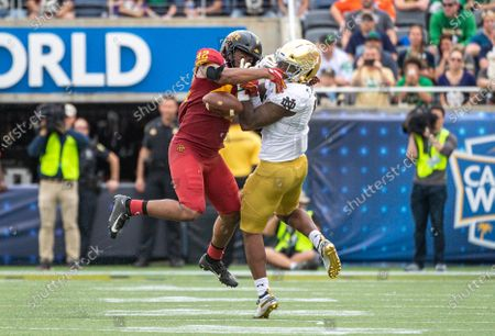Orlando, FL, U.S: Iowa State linebacker Marcel Spears Jr. (42) defends a pass intended for Notre Dame running back Tony Jones Jr. (6) during 1st half of Camping World Bowl between Notre Dame Fighting Irish and Iowa State Cyclones at Camping World Stadium in Orlando, Fl
