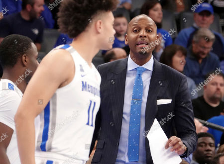 Memphis' head coach Penny Hardaway calls to his players in the first half of an NCAA college basketball game against New Orleans, in Memphis, Tenn