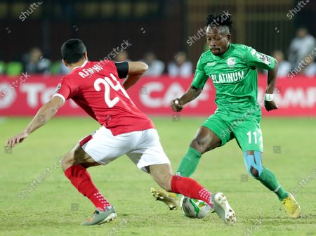 Al-Ahly  player Ahmed Fathi (L) in action against FC Platinum  player Guyve Nsiala (R) during the CAF Champions League soccer match between AL-Ahly and FC Platinum at Al-Salam Stadium in Cairo, Egypt, 28 December 2019.