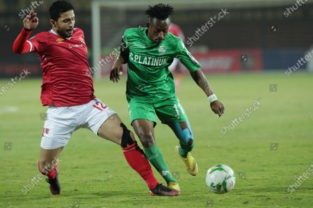 Al-Ahly  player Ayman Ashraf (L) in action against FC Platinum  player Guyve Nsiala (R) during the CAF Champions League soccer match between AL-Ahly and FC Platinum at Al-Salam Stadium in Cairo, Egypt, 28 December 2019.