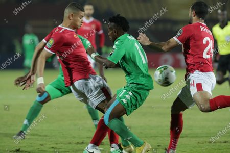 Al-Ahly  player Saad Samir (L) and Ahmed Fathi (R) in action against FC Platinum  player Guyve Nsiala (C) during the CAF Champions League soccer match between AL-Ahly and FC Platinum at Al-Salam Stadium in Cairo, Egypt, 28 December 2019.