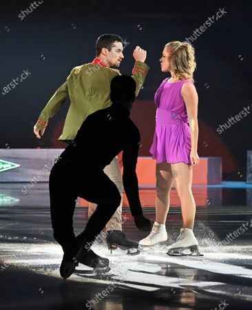 Stock Photo of Spanish figure skater and World Champion Javier Hernandez (L) and US figure skater Ashley Wagner (R) perform during the show 'Revolution on Ice' at the Vistalegre Palace in Madrid, Spain, 28 December 2019, running from 28 December until 29 December in Madrid.