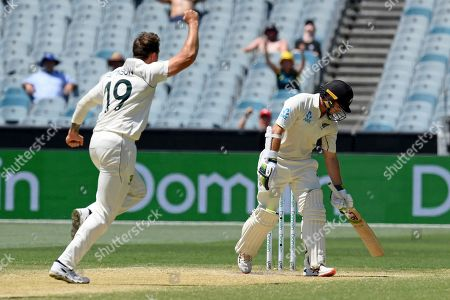 Australia's James Pattinson, left, celebrates the wicket of New Zealand's Tom Latham, right, during their cricket test match in Melbourne, Australia